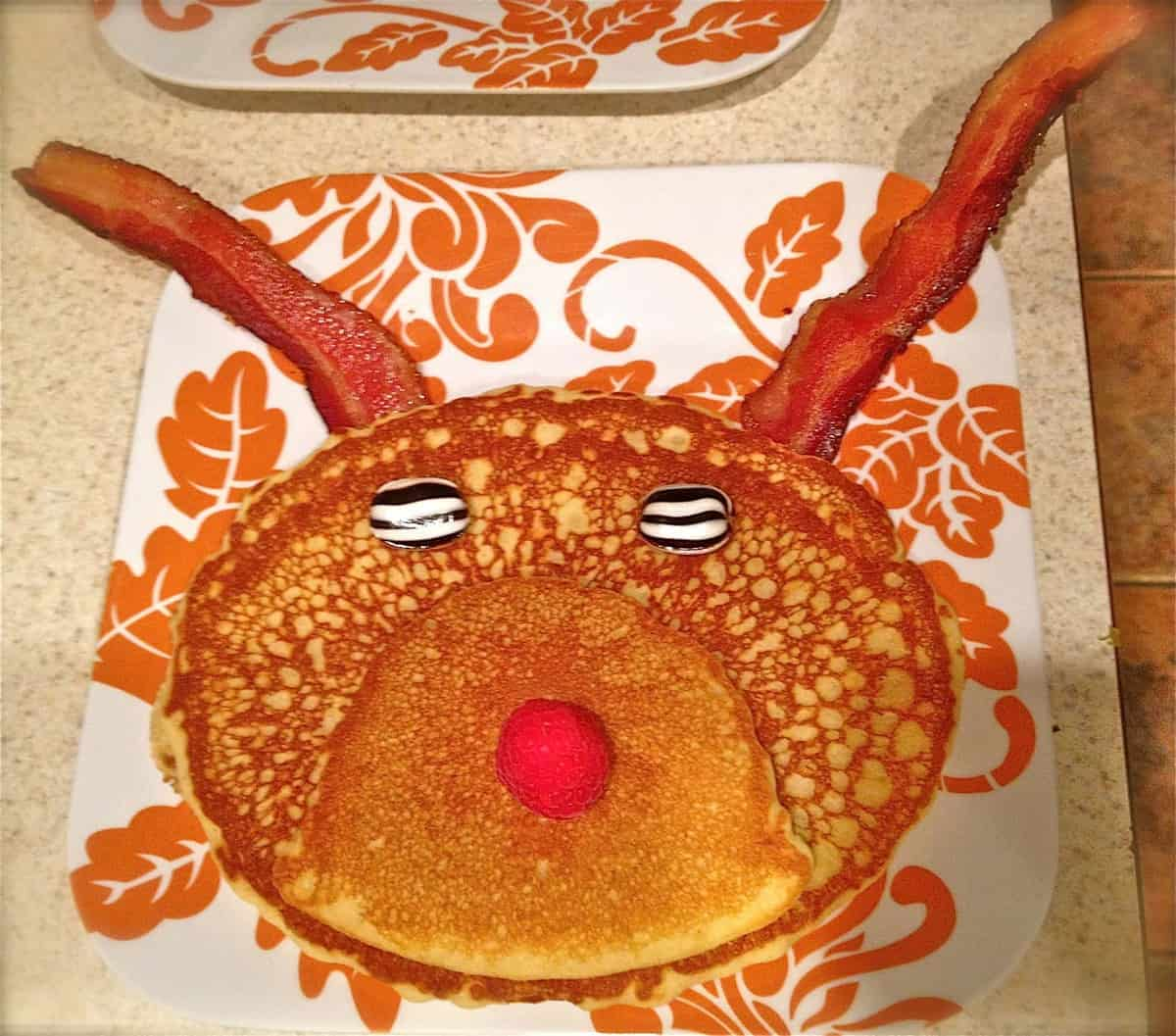 Rudolph the Reindeer Pancakes with Maple Bacon Antlers