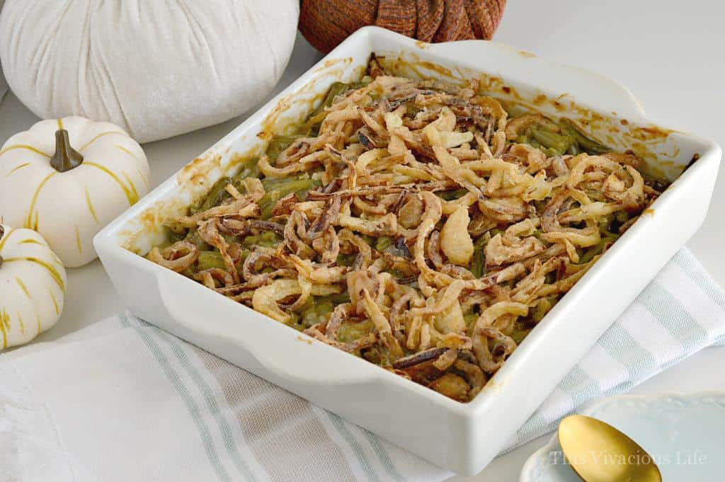 Our gluten-free green bean casserole with homemade fried onions is the perfect accompaniment to your Thanksgiving dinner. It is the best classic Thanksgiving side dish. | gluten free casserole recipes | gluten free side dishes | gluten free vegetable recipes | gluten free thanksgiving recipes | easy gluten free recipes | homemade thanksgiving side dishes || This Vivacious Life #glutenfreesides #greenbeancasserole #thanksgivingsides
