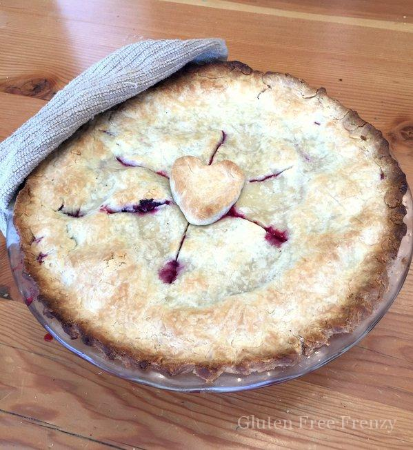 This gluten-free razzleberry pie is full of delicious berries and so easy to make. It's perfect ala' mode during the summer or hot out of the oven at Thanksgiving!