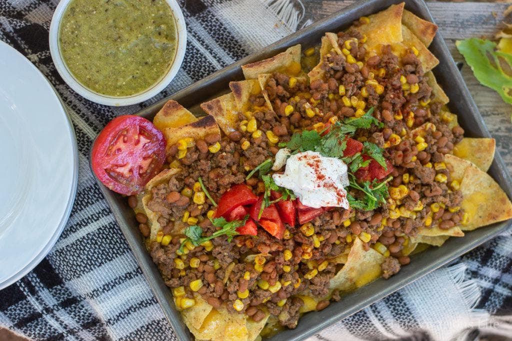 Gluten Free Baked Bean Nachos make a wonderful weeknight dinner because it's both easy to make and to clean up. || This Vivacious Life #recipe #nachos #easydinner #dinner #dinnerrecipes #easyrecipe #nachorecipe #glutenfree #glutenfreedinner #thisvivaciouslife