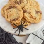 Spider chocolate chip cookies! These delicious and spooky Halloween cookies are sure to please any little ghost or goblin. They only take a few extra minutes from your classic gluten-free chocolate chip cookie too.