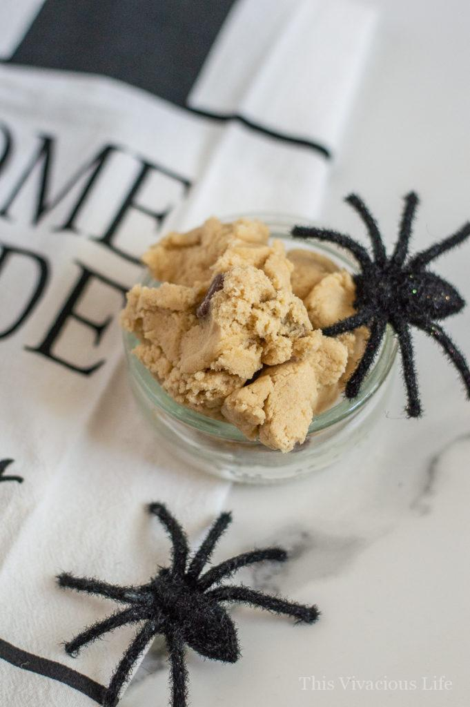 Spider cookie dough with black toy spiders