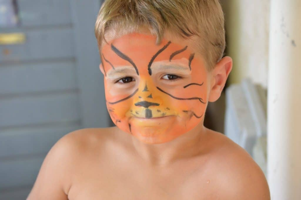 Kid with tiger face paint