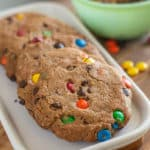Gluten-free monster cookies! These are so easy and because they are semi-homemade, they won't have you slaving in the kitchen all day to make. With just the right amount of honey, gluten-free oats, and plenty of chocolate, you can't go wrong with this kids favorite m&m cookie!
