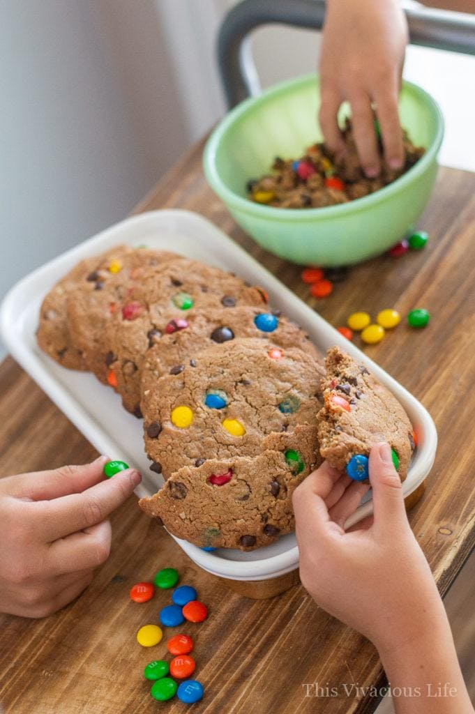 Gluten-free monster cookies! These are so easy and because they are semi-homemade, they won't have you slaving away in the kitchen all day.    This Vivacious Life #recipe #cookies #semihomemade #cookierecipe #monstercookies #chocolate #candycookies #thisvivaciouslife