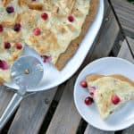 This white cream, turkey and cranberry pizza makes an amazing Thanksgiving leftover meal that everyone will love!