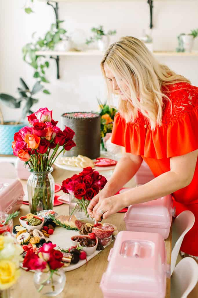 Lady in red decorating Galentines table