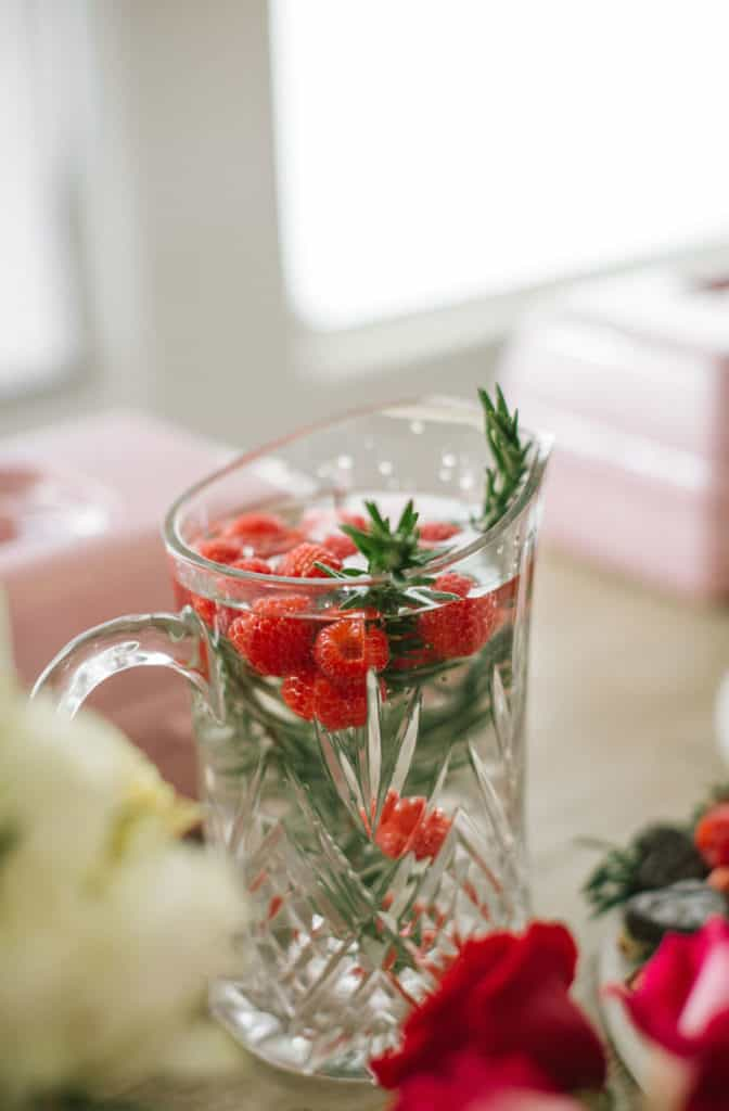 Raspberry rosemary mocktail in crystal pitcher