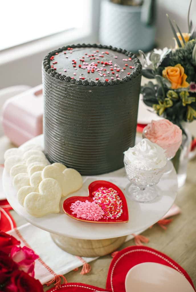 Chocolate Valentines cake on a marble cake stand