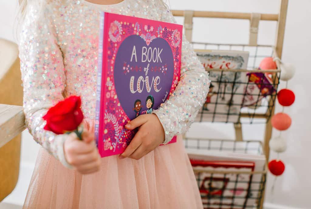 Girl holding Valentines book