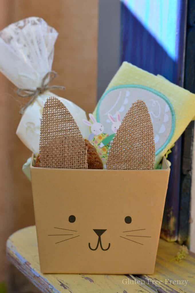 Brown bunny box with icing, towel and cupcake inside