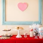 "Galentines Day Favorite Things Party as featured on Hostess with the Mostess! Have you been wanting to create the perfect girls night in for Galentines Day? This party is so fun and easy to put together. From the sweets and cocoa bar, including ooey gooey red velvet cookies (recipe included), to a fries before guys bar, this party has it all. There is even a kiss ""kard"" making station for writing up something kind for your cutie. Each girl brings a few of their favorite things and everybody goes home with the same amount they brought. So fun! There is even a philanthropy aspect with blessing bags they made for the local homeless shelter. Get all the details and photos for this epic DIY party on glutenfreefrenzy.com."