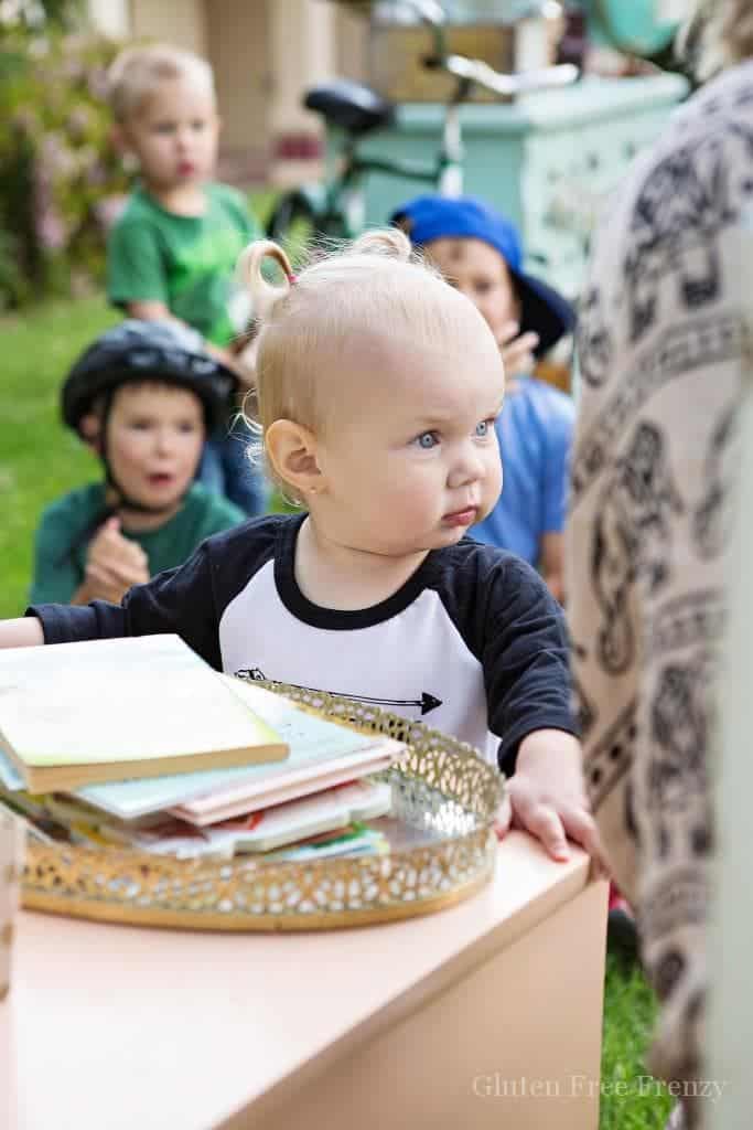 This little library party is a great way to promote literacy in your neighborhood. Delicious goodies including a trail mix piñata cake & popcorn, darling decor and instructions for building your own little library are all here!