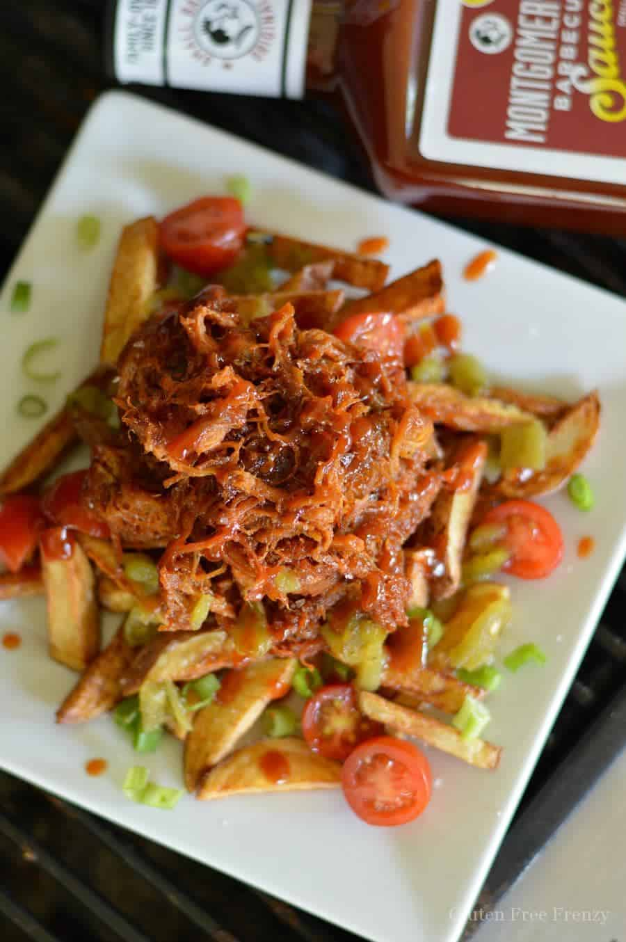 These shredded pork bbq french fries are mouthwatering! My hubby was in awe with how fork tender the Montgomery Inn BBQ ribs were and said they were some of the best he'd had! Don't miss this delicious dinner. glutenfreefrenzy.com