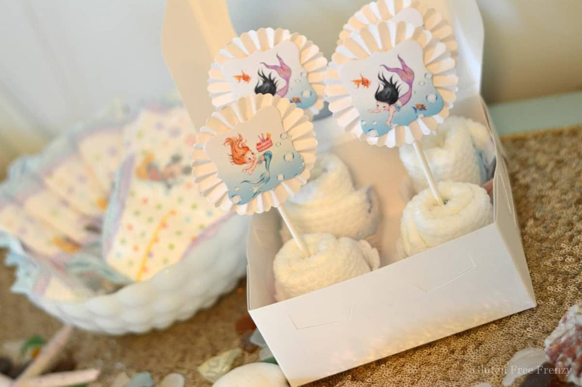 This mermaid themed baby shower couldn't be cuter! So great for little girls but also works as a gender neutral shower with all the white, baby blue and mint green. Clam cookies made from macaroons are so gorgeous and those little mermaids and mermaid tails were darling too! PLUS a DIY diaper cupcake tutorial and more... glutenfreefrenzy.com