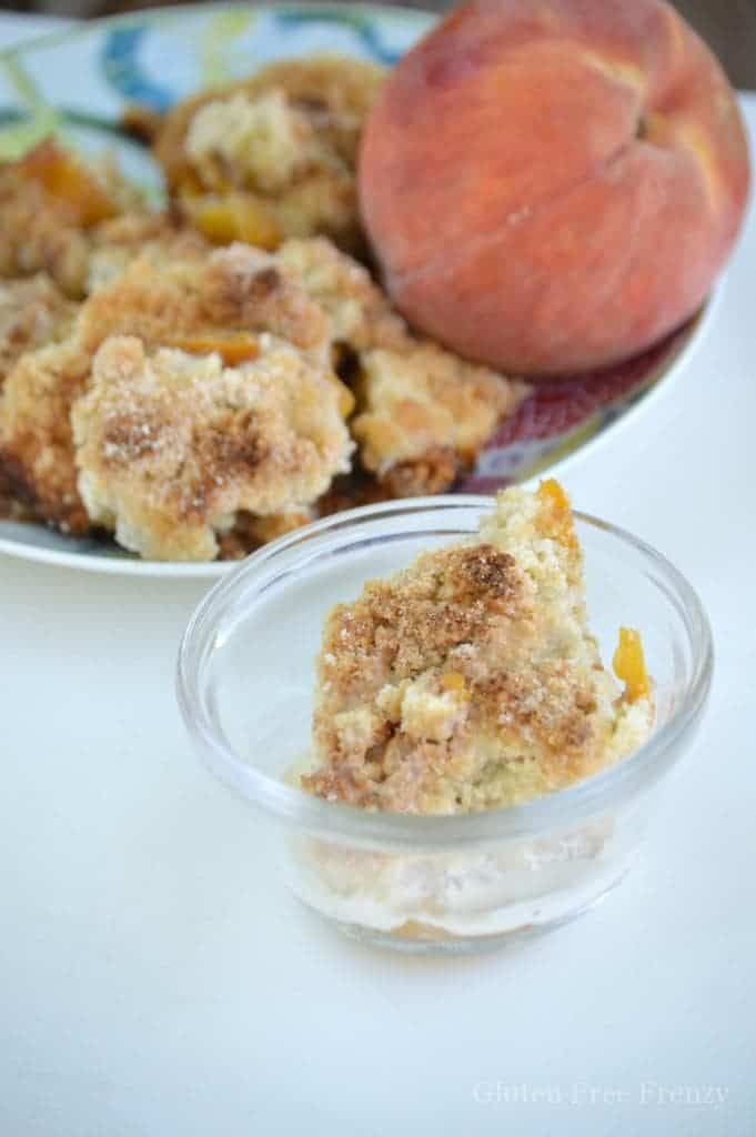Mom's famous gluten-free peach cobbler is easy and delicious! This sweet dessert will remind you of long summer days. At the same time, the warm nutmeg sugared topping will let you know that fall is not far away. This easy dessert is best served with fresh cream. glutenfreefrenzy.com