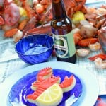 This cajun seafood boil party is so fun! If you have always wanted to host a seafood boil or clambake, this party is for you! Complete with lobster and lemon decorated sugar cookies, Old Bay popcorn and LOTS of seafood. Get all the details for throwing your own at glutenfreefrenzy.com