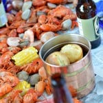 This lobster boil party is so fun! If you have always wanted to host a seafood boil or clambake, this party is for you! Complete with lobster and lemon decorated sugar cookies, Old Bay popcorn and LOTS of seafood. Get all the details for throwing your own at glutenfreefrenzy.com