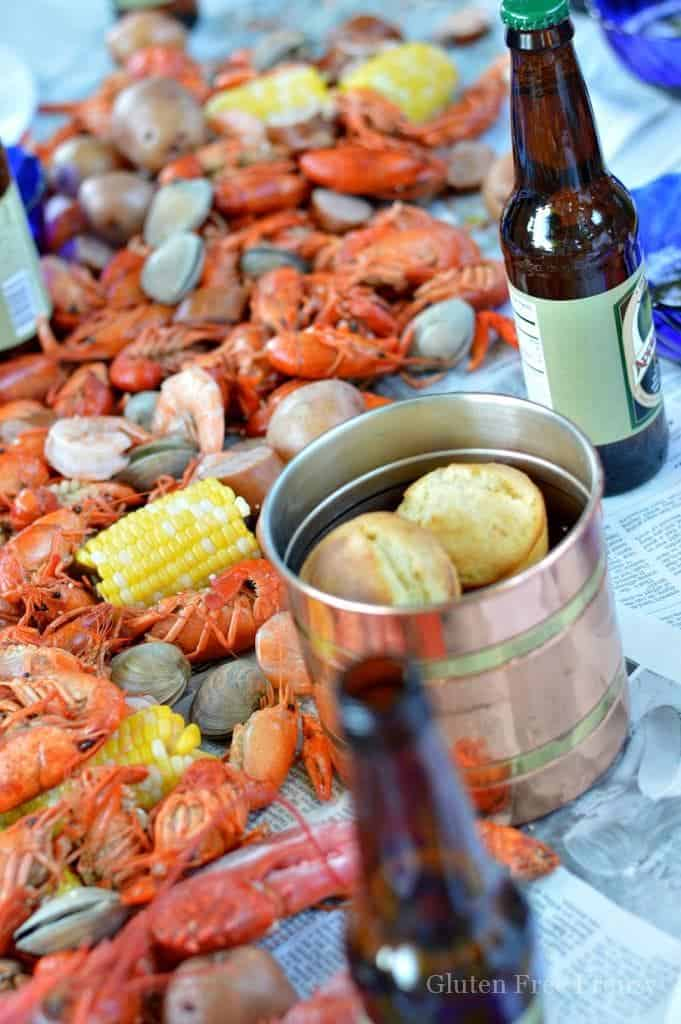 This lobster boil party is so fun! If you have always wanted to host a seafood boil or clambake, this party is for you! Complete with lobster and lemon decorated sugar cookies, Old Bay popcorn and LOTS of seafood. Get all the details for throwing your own at glutenfreefrenzy.com | Outdoor Party Ideas | Lobster Boil Recipe | Fun Entertaining Ideas || This Vivacious Life