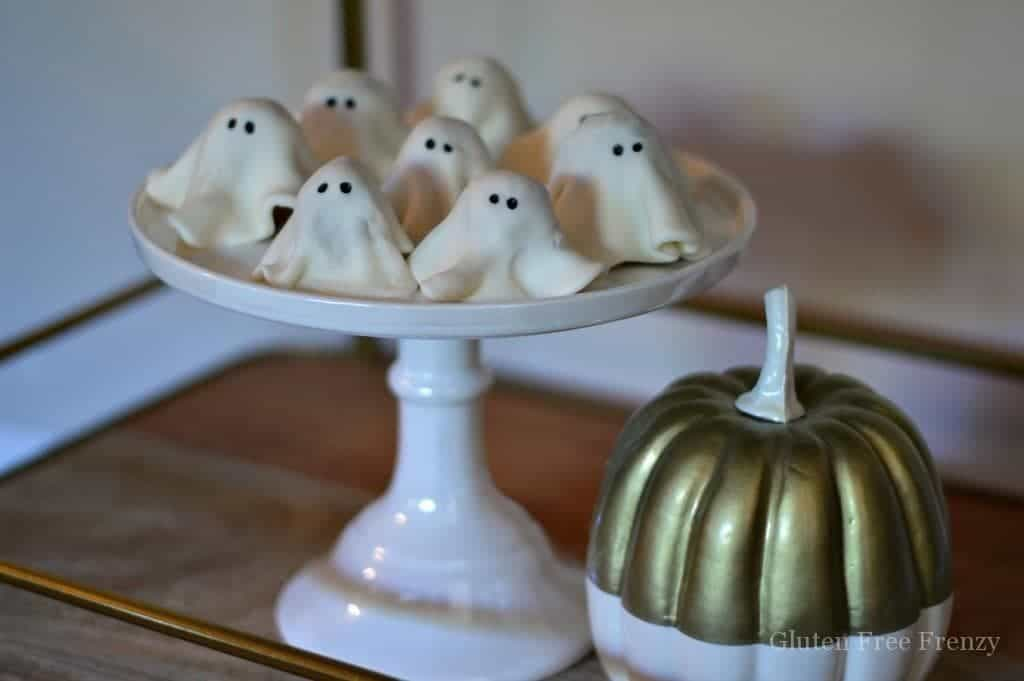 These no-bake ghost cookies are SO delicious that you won't be able to eat just one! They are so easy to make and couldn't be cuter. They are gluten-free but nobody would every know. They are perfect for your Halloween party. | no-bake cookie recipes | halloween treat recipes | halloween cookie recipes | easy halloween recipes | halloween dessert recipes | gluten-free halloween desserts | gluten-free halloween treats | fun gluten-free recipes || This Vivacious Life