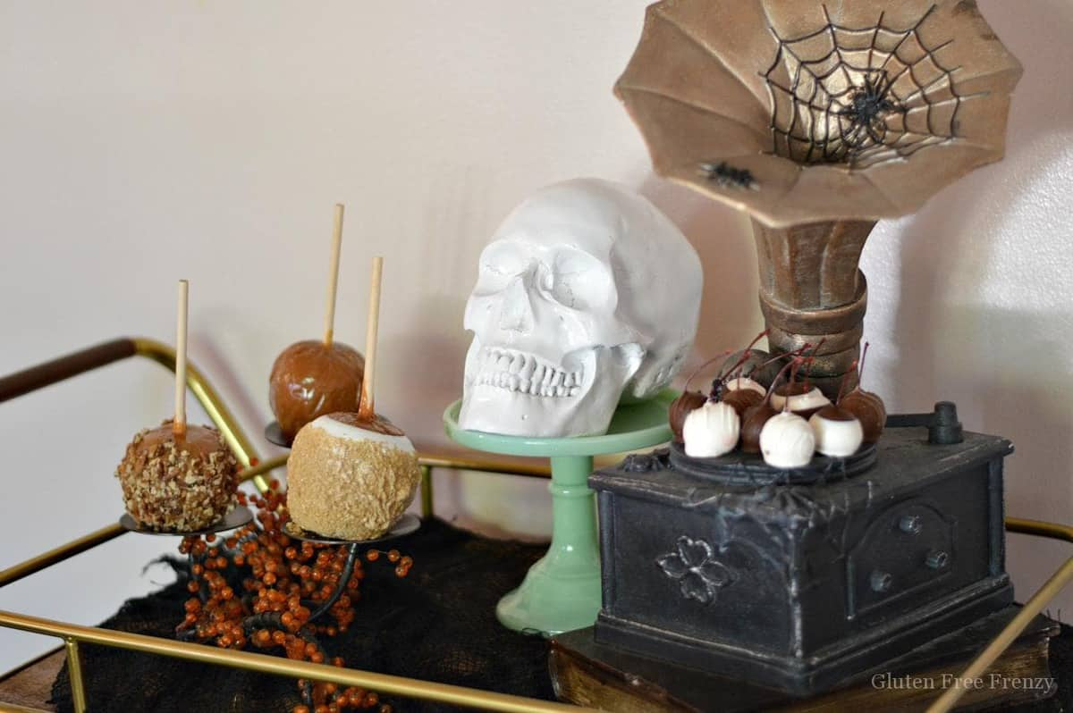 Experience the mysterious magic of the season with a Halloween styled bar cart and treat cart. Decor that can last all month long is easy to achieve without breaking the bank. Add a few spooky touches along with a display of your favorite treats and you will have a fantastic Halloween treat cart perfect for your next party! glutenfreefrenzy.com