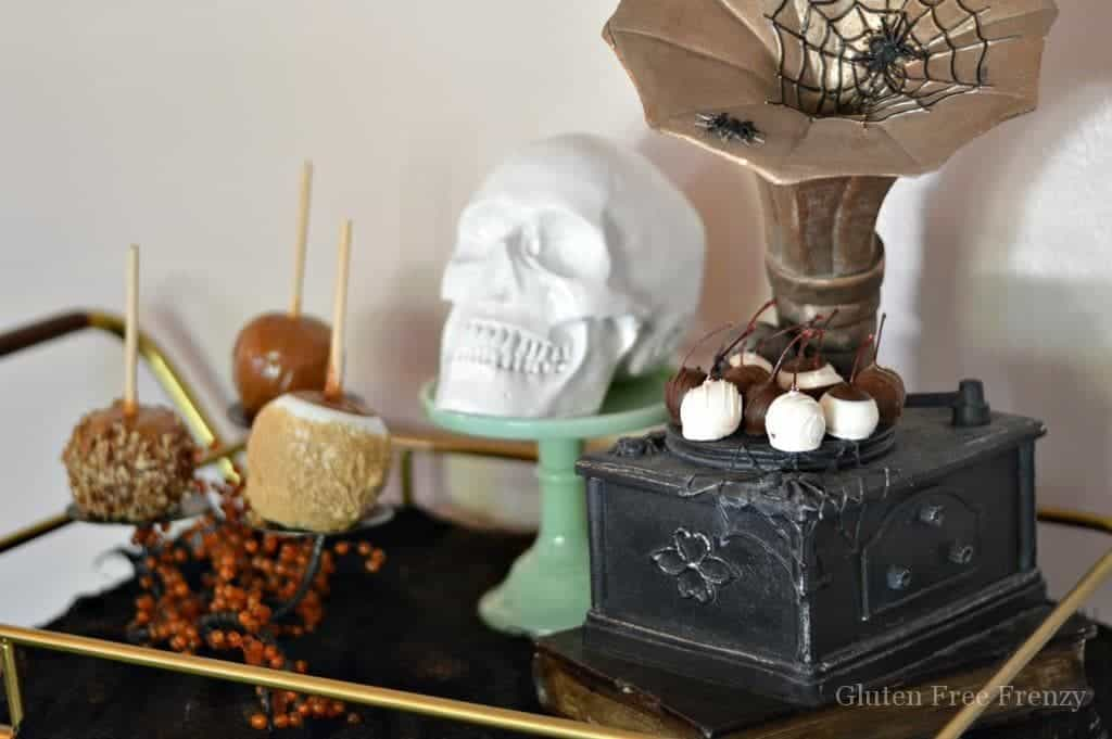 Experience the mysterious magic of the season with a Halloween styled bar cart and treat cart. Decor that can last all month long is easy to achieve without breaking the bank. Add a few spooky touches along with a display of your favorite treats and you will have a fantastic Halloween treat cart perfect for your next party! | DIY Halloween Decor | Halloween Decorations | How to Decorate for Halloween || This Vivacious Life
