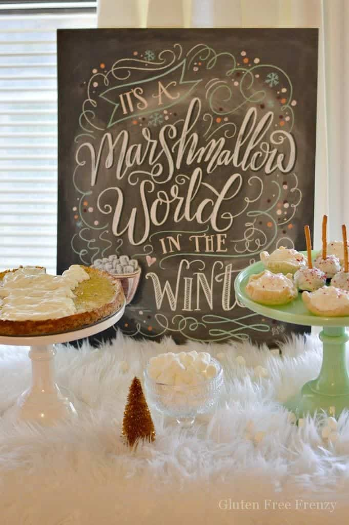 This marshmallow Christmas party is full of sweet treats and a full tablescape. From white bottlebrush trees to a fluffy white cloth, you will truly feel like you are walking through a marshmallow world. | winter party ideas | Christmas party ideas | winter wonderland party | hosting a winter party | gluten free party ideas || This Vivacious Life #winterwonderland #winterparty