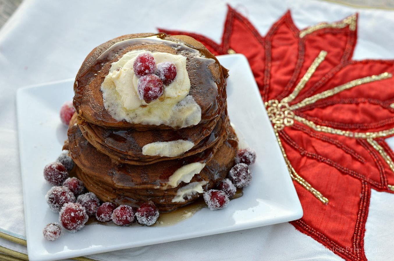 Oh holly jolly, these gluten-free gingerbread pancakes are full of holiday flavors and spices. They are so delicious nobody would ever know they are gluten-free. Serve them with sugared cranberries on top.