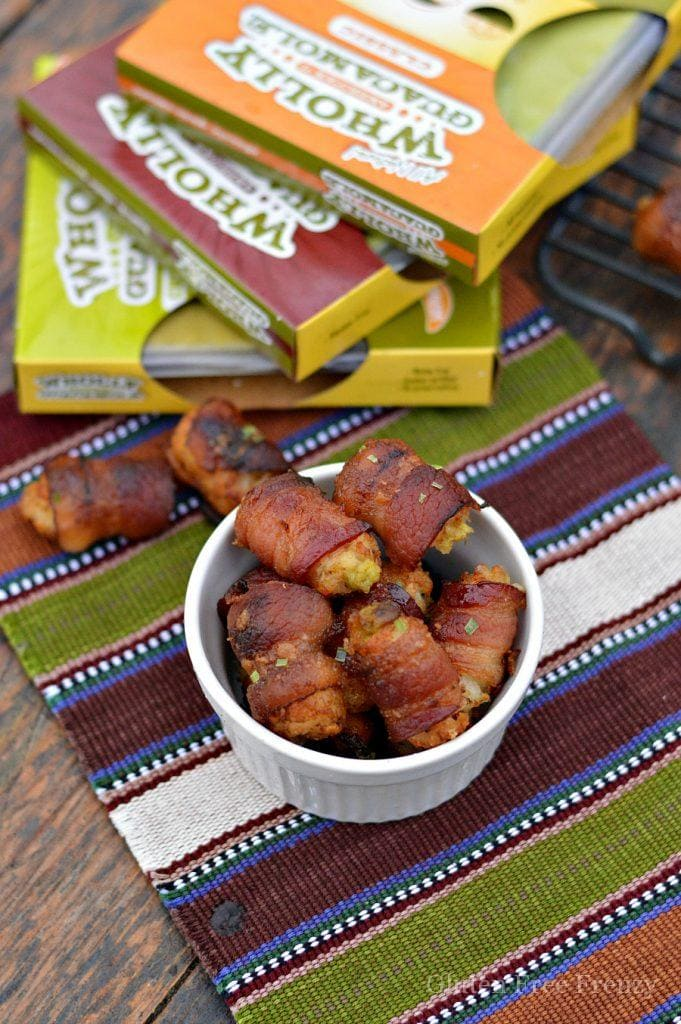 Guacamole stuffed tater tot bacon bombs are going to be a HUGE hit at your next gathering. They are the perfect appetizer for New Years Eve or Superbowl.