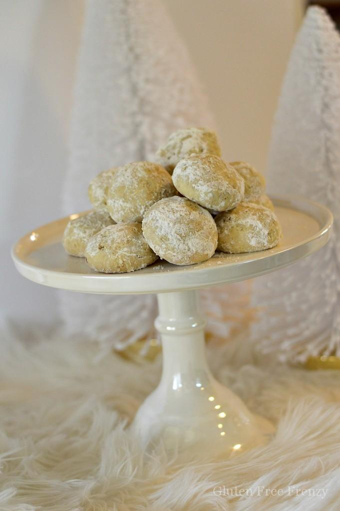 Our gluten-free snowball cookies are a fun way to get into the holiday spirit. They are simple, delicious and full of powdery white sugar. | gluten-free holiday cookies | gluten-free christmas cookies | gluten-free cookies | gluten-free holiday recipes | gluten-free holiday treats | gluten-free holiday desserts || This Vivacious Life #snowballcookies #glutenfreechristmas #glutenfreecookies