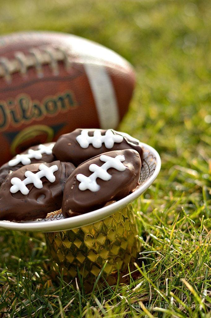These gluten-free cookie dough footballs are perfect for your next sports night or Superbowl party. | gluten-free superbowl | gluten-free football desserts | gluten-free superbowl party | gluten-free cookie dough recipes | fun gluten-free recipes || This Vivacious Life #glutenfreesuperbowl #glutenfreecookiedough #glutenfreefootball