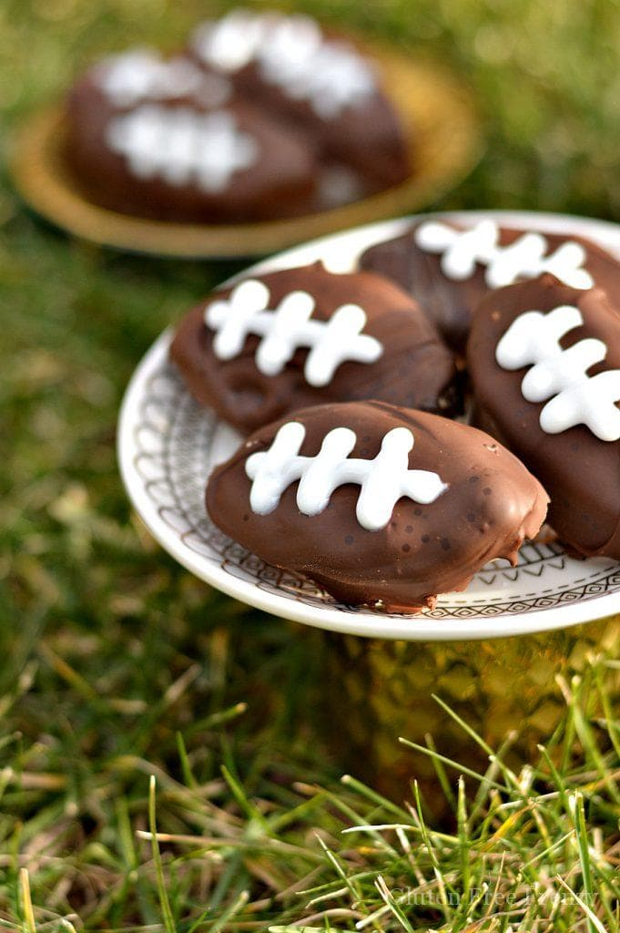 Chocolate covered gluten-free cookie dough footballs on a plate
