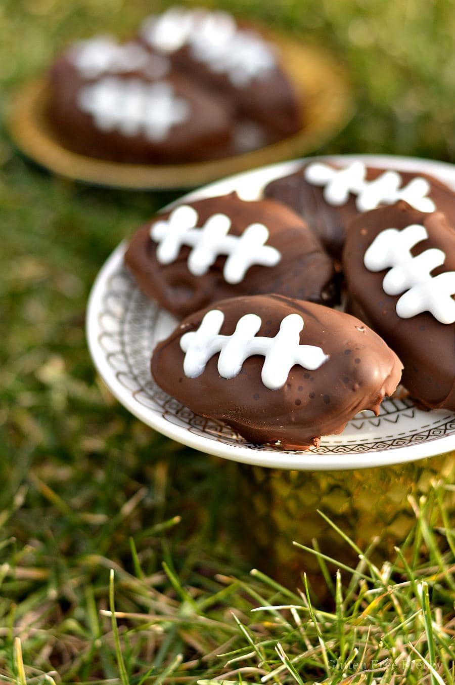 These gluten-free cookie dough footballs are perfect for your next sports night or Superbowl party. They are easy to make and everyone will love them!