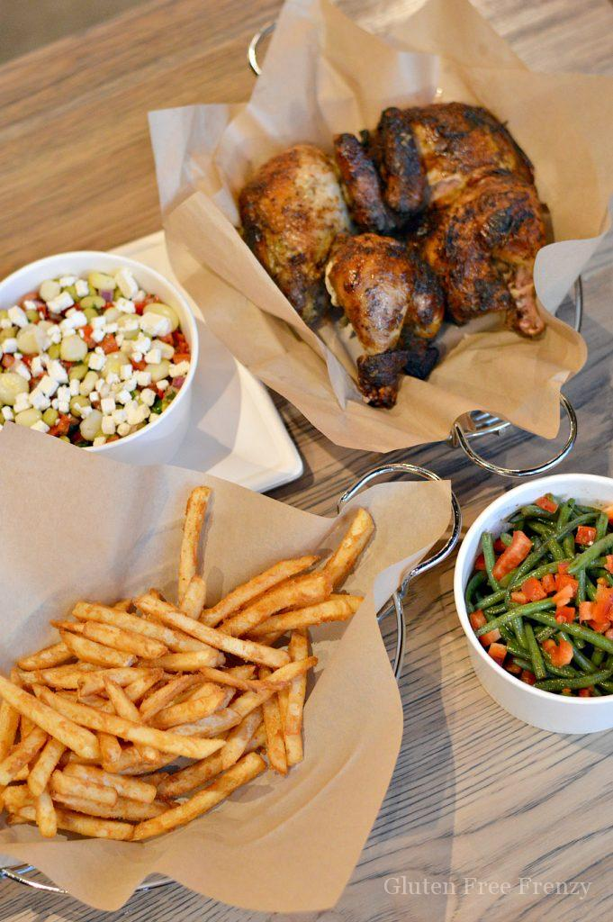 French fries, bean salad, green beans and a roasted chicken