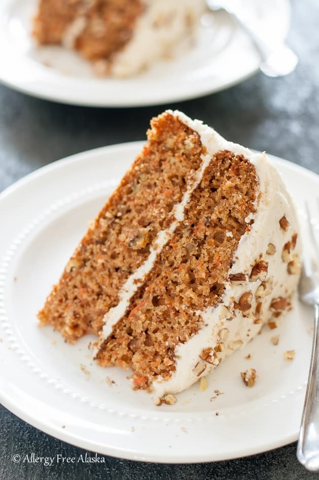 A slice of carrot cake with cream cheese frosting