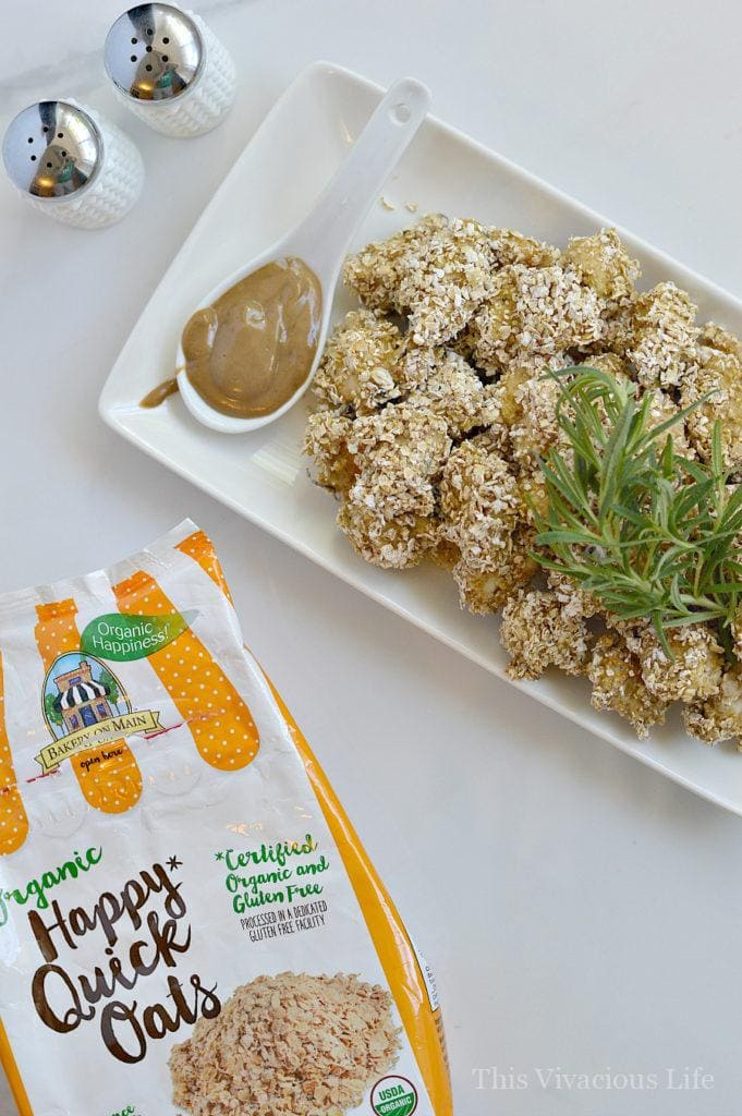 These rosemary oaty chicken nuggets are a healthy twist to a classic chicken nuggets recipe. They are baked and full of flavor. | healthy chicken nuggets | gluten free chicken recipes | gluten free appetizers | gluten free recipes | baked chicken recipes || This Vivacious Life #bakedchicken #glutenfreechicken #healthychickennuggets