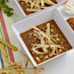 This Instant Pot shredded beef taco soup is so delicious and easy to make. It can be made easily with leftovers during the week for dinner. It's even gluten-free. There is also a crockpot variation.