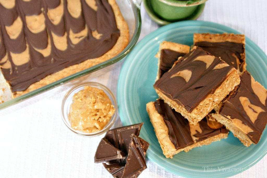 These gluten-free peanut butter bars with chocolate peanut butter frosting are a decadent treat that everyone will enjoy! They are easy to make and are a chewy and rich dessert.