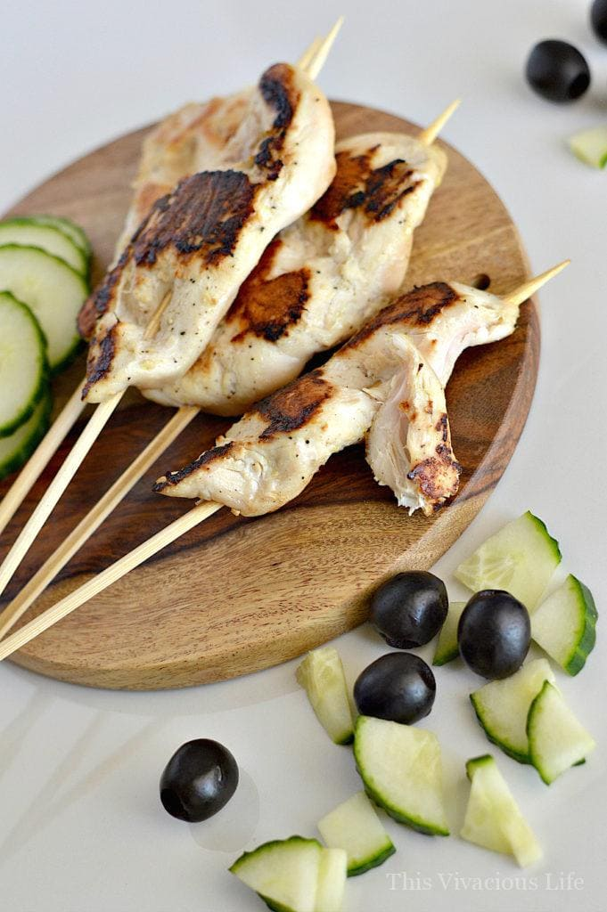 Yum, marinated chicken skewers with cucumber yogurt sauce are great for summer grilling and full of fresh flavors. The chicken is so tender and the sauce creamy and cool along side the perfectly grilled chicken that is great for dinner.