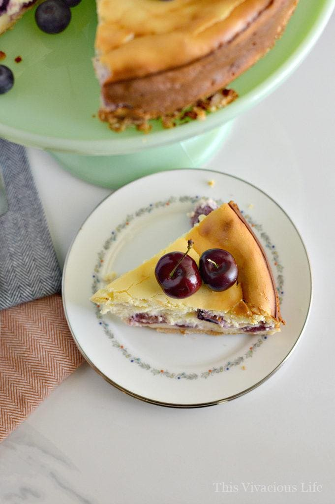 This gluten-free almond cherry cheesecake is rich, decadent and so delicious! It is a dessert bursting with fresh, summer flavors. || This Vivacious Life #recipe #cheesecake #glutenfree #summerdessert #summerrecipe