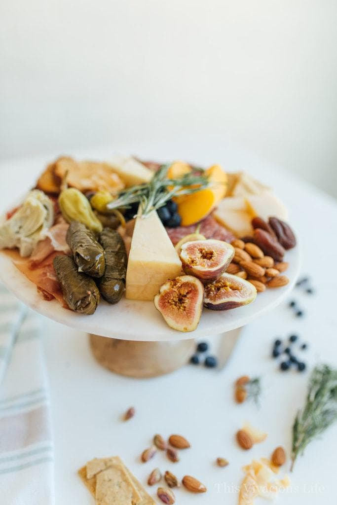 Gluten-Free Charcuterie and Cheeseboard Perfect for Entertaining | gluten free entertaining tips | how to entertain gluten free | gluten free appetizer ideas | gluten free charcuterie tips | how to create gluten free charcuterie | gluten free cheeseboard | gluten free snack recipes || This Vivacious Life #charcuterie #glutenfree #cheese #appetizer #cheeseboard #entertaining #recipes #glutenfreesnacks #snacks