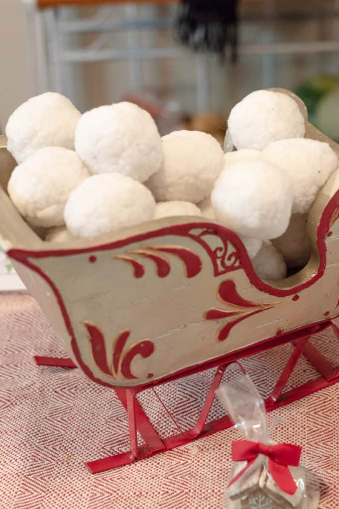 Cotton snowballs in a silver and red sleigh
