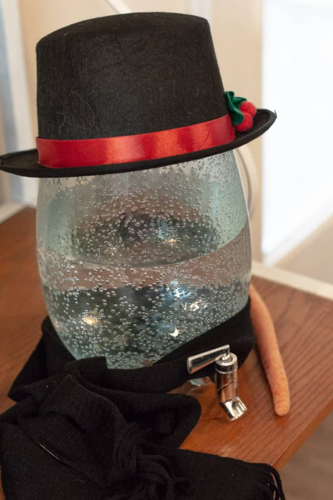 Melted snowman drink (water jug with hat and scarf)