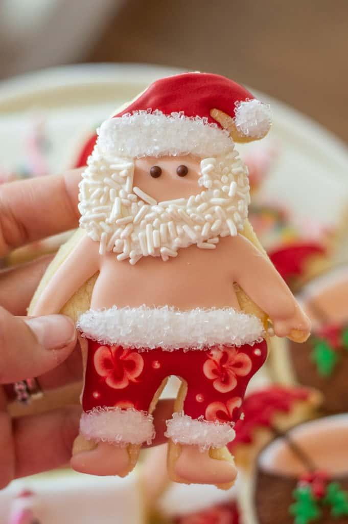 Santa in swimsuit sugar cookie