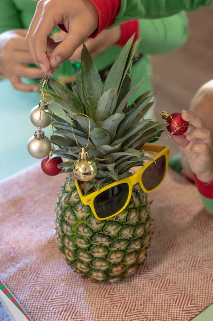 Pineapple decorated with mini bulbs and sunglasses