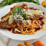 This is truly the best gluten-free chicken parmigiana out there! It is a little crispy and perfectly flavored. Plus, it's pretty simple to make as well.