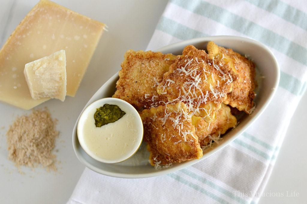 gluten-free fried ravioli with pesto Alfredo sauce