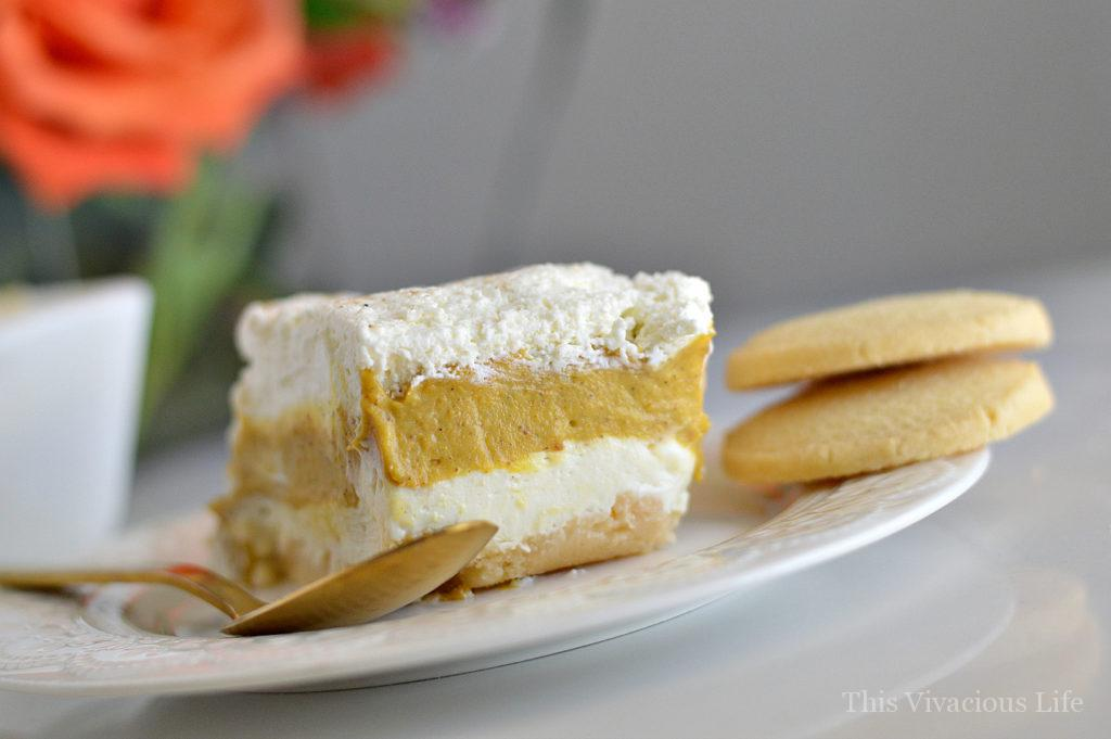 This gluten-free pumpkin pie cream delight is a delicious and festive dessert. It is bursting with fun fall flavors and one that is perfect for Halloween or Thanksgiving.   gluten-free pumpkin desserts   gluten-free fall desserts   gluten-free thanksgiving desserts   gluten-free recipes for fall   pumpkin recipes for thanksgiving   gluten-free thanksgiving recipes    This Vivacious Life #glutenfreethanksgiving #glutenfreepumpkin #glutenfreedesserts #glutenfreefall