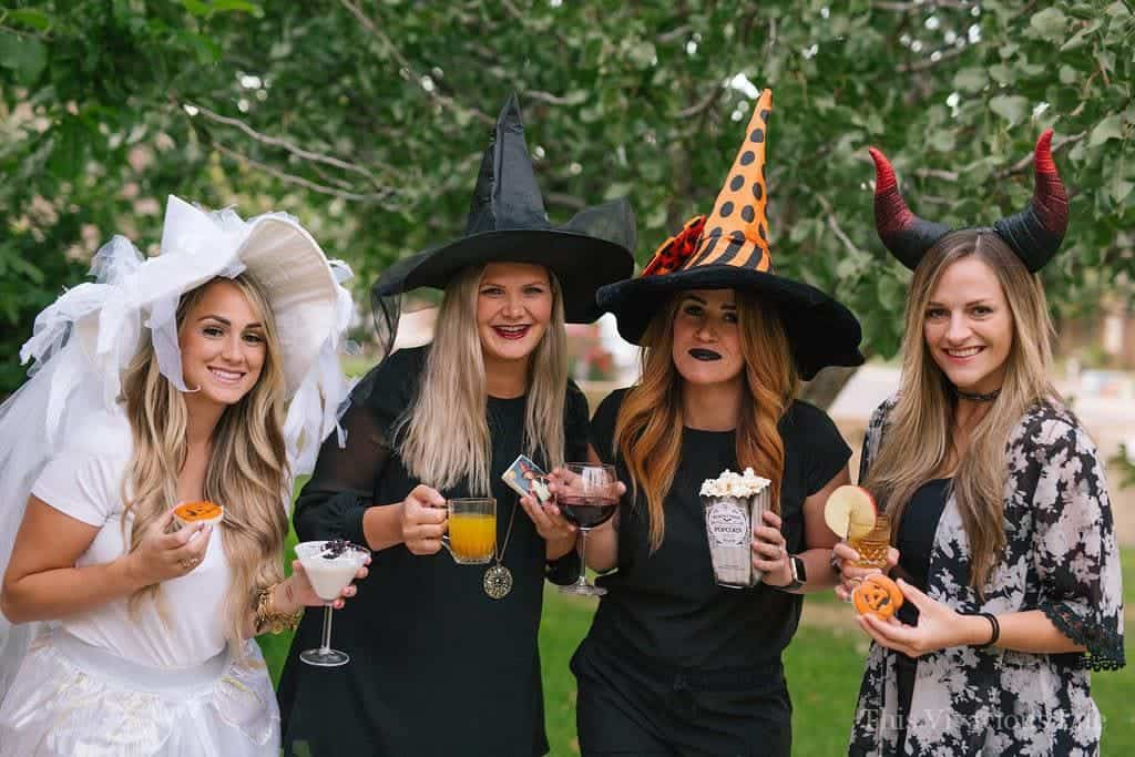 Four ladies dressed as witches for Halloween