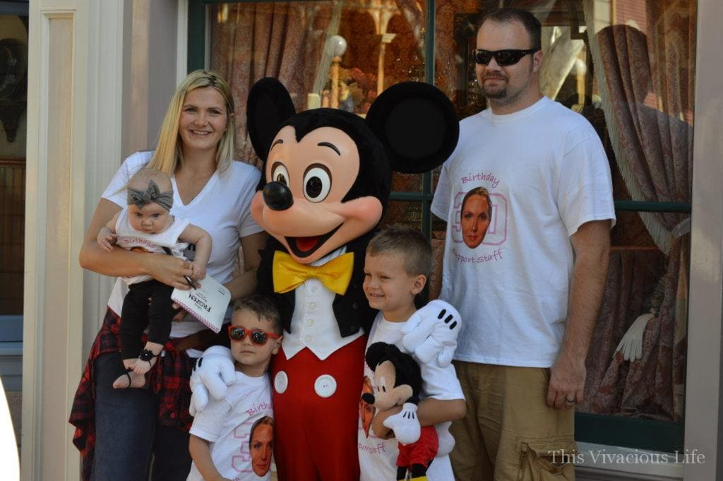 Family of 5 with Mickey Mouse at Disneyland